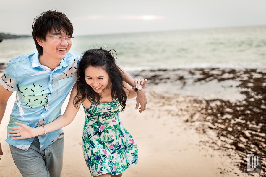 prewedding in tegal wangi beach bali love couple cave rock beach cliff sunset