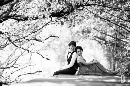 Prewedding in Mangrove Forest Bali love happy smile with couple in the intimate sun light and blue sky black and white
