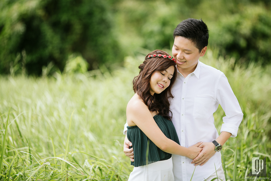 casual prewedding in ubud bali smile happy with love couple sun day light green grass