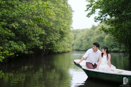 prewedding in mangrove forest in Lembongan Island Bali with love couple in the intimate sun light and blue sky