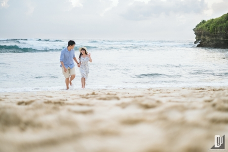 Prewedding in Lembongan Island Bali happy love smile daylight beach with blue sky wind and sea casual hug kiss waves water sand