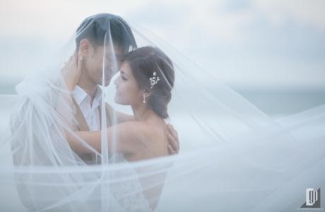 Prewedding in Tegal Wangi Beach Bali happy love smile happy sunset beach romantic hug kiss white dress and tuxedo veil