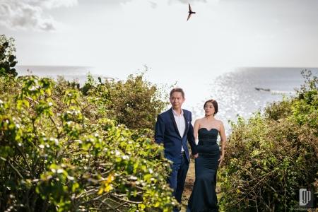 prewedding in tegal wangi beach bali love happy smile couple cave rock beach cliff blue sky