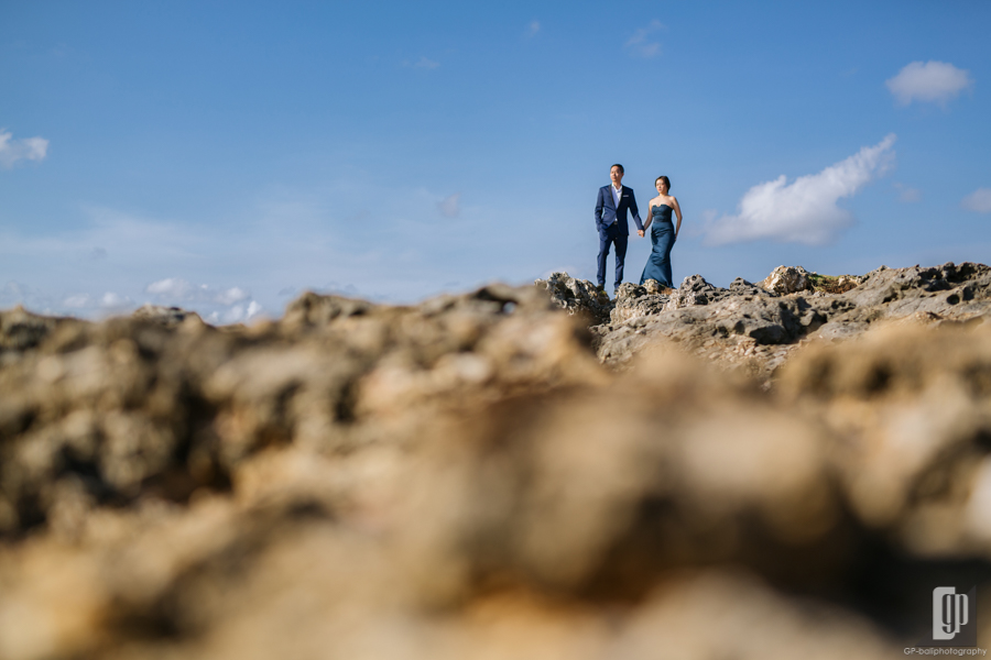 prewedding in tegal wangi beach bali love happy smile couple cave rock beach cliff blue sky