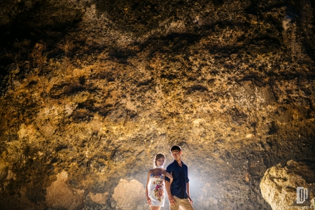 Prewedding in Waterfall Bali happy love smile happy sunset beach stone cliff casual romantic hug kiss