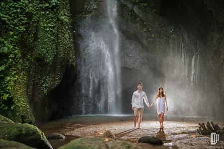 Prewedding in Waterfall Bali happy love smile sun daylight with white dress and white shirt casual waterfall romantic