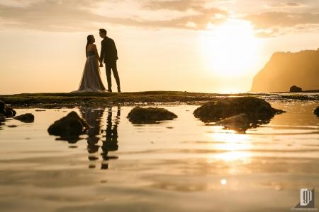 Prewedding in Melasti Beach Bali happy love smile happy sunset romantic hug kiss gray dress and tuxedo cliff