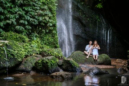 Prewedding in Waterfall Pengempu Bali happy love smile sun daylight with white dress and white shirt casual waterfall romantic