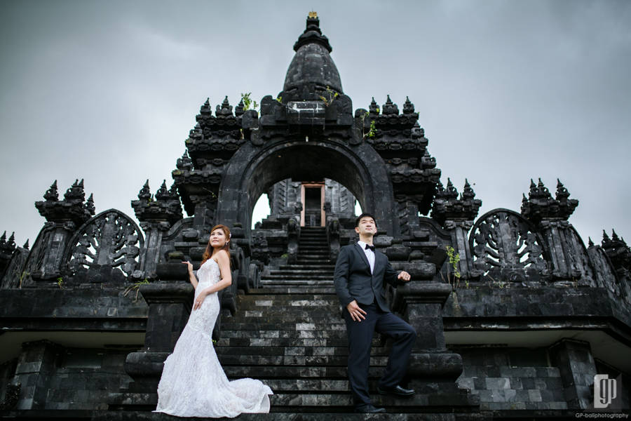 Prewedding in Taman Mumbul Nusa Dua Bali happy love smile happy cloudy romantic white dress and tuxedo monument